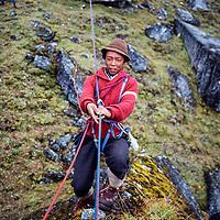 Lakpa Dorje Sherpa (Phortse) practices a Tyrolean traverse at an early mountaineering school for sherpas in the Khumbu region of Nepal, 1980.