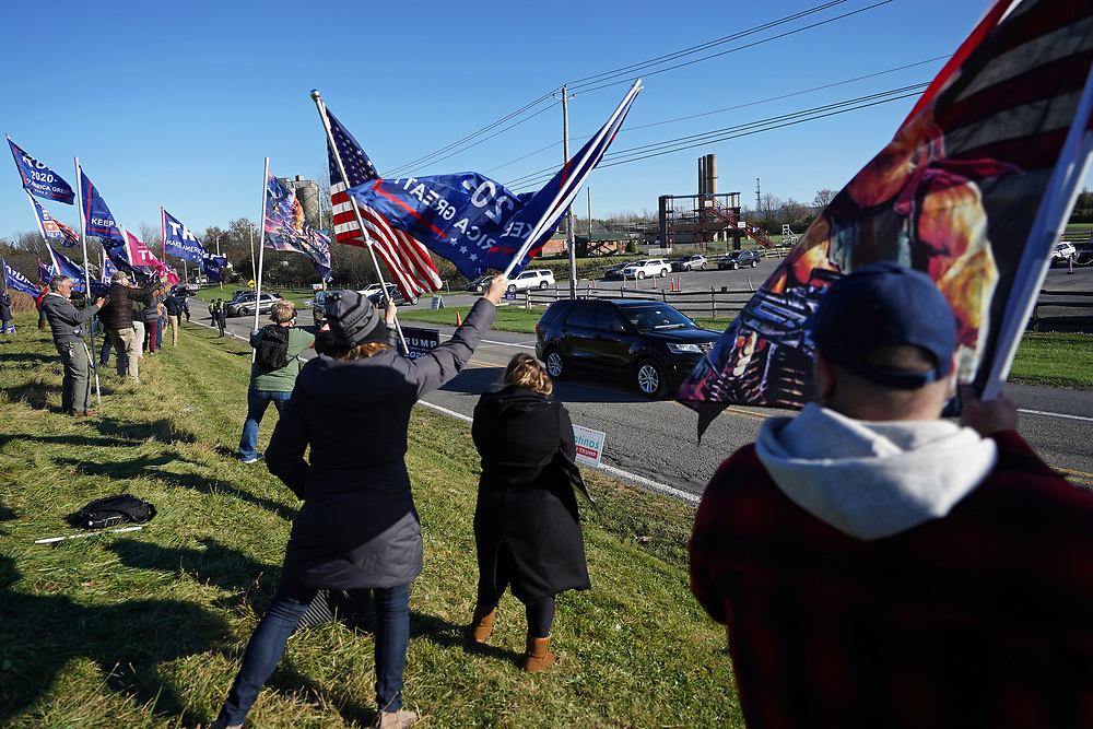 Supporters of President Donald Trump become vocal as the motorcade carrying Sen. Kamala Harris, staff and media, pass by at Dutch Springs on Nov. 2, 2020, before a drive-in rally in Bethlehem Township, Pennsylvania.
