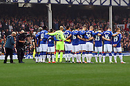 Everton players hold a minute's applause for Remembrance Sunday. Barclays Premier League match, Everton v Sunderland at Goodison Park in Liverpool on Sunday 1st November 2015.<br /> pic by Chris Stading, Andrew Orchard sports photography.