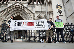 © Licensed to London News Pictures. 10/07/2017. London, UK. Protestors wait for a decision outside the High Court. The court is ruling on whether the UK Government has acted illegally by not suspending arms sales to Saudi Arabia in the face of evidence that shows that they are in serious breach of humanitarian law - especially in connection with the war in Yemen. Photo credit: Peter Macdiarmid/LNP