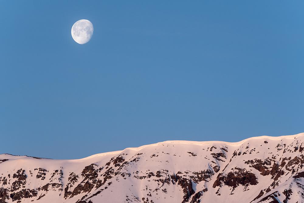 Moon over Chief Joseph Mountain, Wallowa Mountains, Oregon.