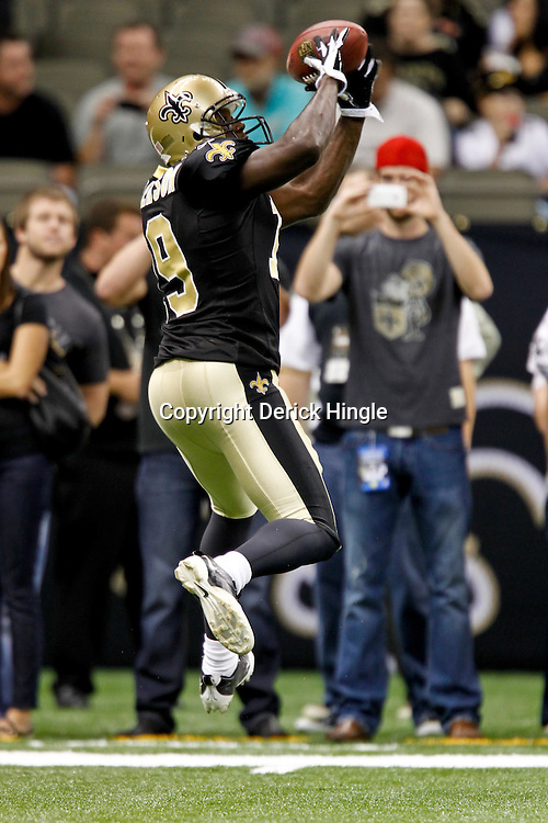 September 1, 2011; New Orleans, LA, USA; New Orleans Saints wide receiver Devery Henderson (19) during warm ups prior to kickoff of a preseason game against the Tennessee Titans at the Louisiana Superdome. The Titans defeated the Saints 32-9. Mandatory Credit: Derick E. Hingle