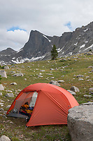 Red tent at Backcountry camp, Pronghorn Peak is in the distance. Bridger Wilderness. Wind River Range, Wyoming