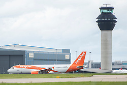 © Licensed to London News Pictures. 03/09/2020. Manchester, UK.  Easyjet flight U21880 lands at Manchester Airport from Faro, Portugal. Portugal could be added to the UK quarantine list today. Photo credit: Kerry Elsworth/LNP