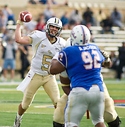 Dec 1, 2012; Tulsa, Ok, USA; University of Central Florida Knights quarterback Blake Bortles (5) makes a pass around Tulsa Hurricanes defensive tackle Derrick Jackson (92) during a game at Skelly Field at H.A. Chapman Stadium. Tulsa defeated UCF 33-27 in overtime to win the CUSA Championship. Mandatory Credit: Beth Hall-USA TODAY Sports