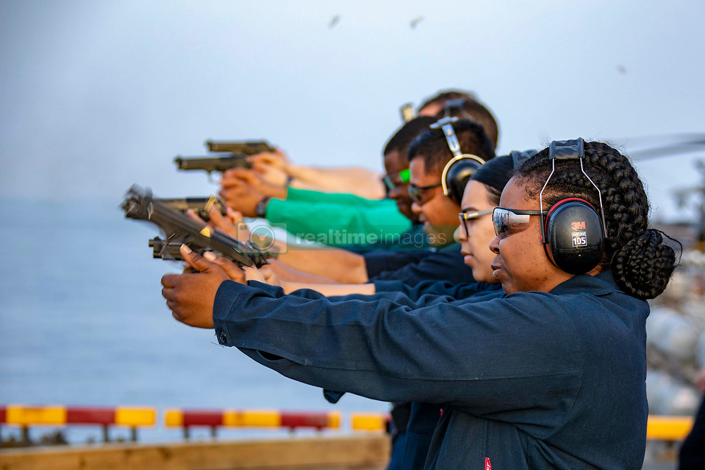 190312-N-JN023-1262 <br /> U.S. 5TH FLEET AREA OF OPERATIONS (March 12, 2019) Sailors fire M9 pistols during a live-fire exercise on the flight deck aboard the Wasp-class amphibious assault ship USS Kearsarge (LHD 3). Kearsarge is the flagship for the Kearsarge Amphibious Ready Group and, with the embarked 22nd Marine Expeditionary Unit, is deployed to the U.S. 5th Fleet area of operations in support of naval operations to ensure maritime stability and security in the Central Region, connecting the Mediterranean and the Pacific through the western Indian Ocean and three strategic choke points. (U.S. Navy photo by Mass Communication Specialist 2nd Class Megan Anuci/Released)