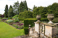 Decorative urns on a stone balustrade and stiars leading to the double herbaceous borders at Newby Hall, Ripon, Yorkshire, UK