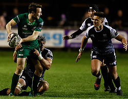 Jack Carty of Connacht is tackled by Dan Lydiate of Ospreys<br /> <br /> Photographer Simon King/Replay Images<br /> <br /> Guinness PRO14 Round 7 - Ospreys v Connacht - Friday 26th October 2018 - The Brewery Field - Bridgend<br /> <br /> World Copyright © Replay Images . All rights reserved. info@replayimages.co.uk - http://replayimages.co.uk