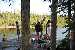 "First Nation Dene youth gather  during a spiritual gethering in Reliance after a group returns on a canoe trip from the Upper Thelon River is ""the place where God began.""  Sparsely populated, today few make it into the Thelon. Distances are simply too far, modern vehicles too expensive and unreliable. For the Dene youth, faced with the pressures of a western world, the ties that bind the people and their way of life to the land are even more tenuous. Every impending mine, road, and dam construction threatens to sever these connections. In July and August, 2011 a group of youth paddled to their ancestral hunting ground and spiritual abode.  this next generation of young leaders will be the ones who will need to speak for the Thelon the loudest. (Photo by Ami Vitale)"