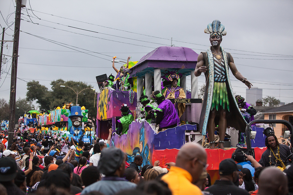 Floats in the Zulu parade ride through large crowds on Fat, Tuesday, Mardi Gras Day. Mardi Gras 2011 in New Orleans is expected to be have the largest attendance of all time due to the dates overlapping with college spring break. Mardi Gras also known as Carnival begins on or after Epiphany and ending on the day before Ash Wednesday.