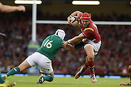 Tyler Morgan of Wales breaks away from Ireland's Rory Best. Wales v Ireland rugby union international, RWC warm up friendly match at the Millennium Stadium in Cardiff, South Wales on Saturday 8th August  2015.<br /> pic by Andrew Orchard, Andrew Orchard sports photography.