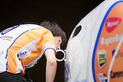 David Wielemaker controleert een naad op de VeloX2. Op de TU Delft wordt de VeloX2 getest in de windtunnel. Met de VeloX2 wil het Human Powered Team Delft en Amsterdam, bestaande uit studenten van de TU Delft en de VU Amsterdam, het werelduurrecord en het sprint record gaan breken.<br /> <br /> David Wielemaker checks the juncture on the VeloX2.The VeloX2 is tested on aerodynamics at the wind tunnel of TU Delft. With the VeloX2 the Human Powered Team Delft and Amsterdam are trying to break the speed records for human powered vehicles.