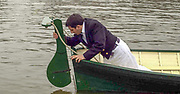 """Putney. London.  2004 University Boat Race,  Championships Course, Putney to Mortlake. <br /> Re enactment row Boat Race. , Cambridge and Oxford . OUBC cox Neil CHUGANI,  Boating from the  """"Hard"""", pots the rudder in place.  [Mandatory Credit Peter SPURRIER]"""