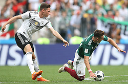 Germany's Julian Draxler (left) and Mexico's Hector Herrera in action during the game