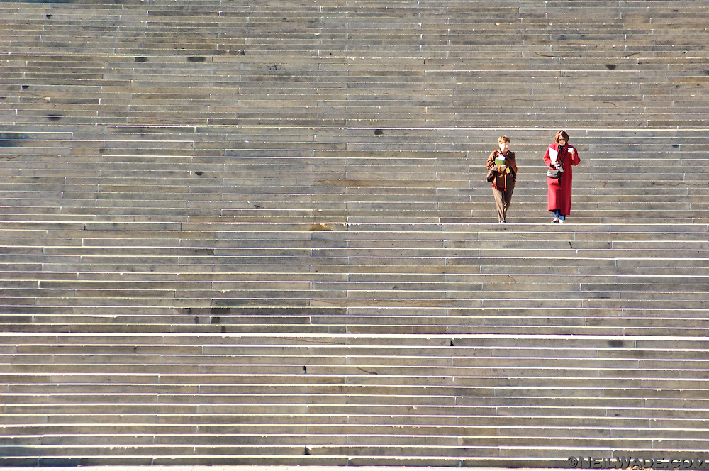 Two women descend the famous stairs in front of The Philadelphia Art Museum.