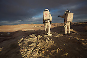 - Hanksville, Utah, U.S. - <br /> <br /> Life On Mars<br /> <br /> The Mars Society operates simulated Mars Missions here on Earth to teach scientists how to live and work on another planet, and is is dedicated to encouraging the exploration and settlement of Mars. This six-person international crew included engineers, and a biologist all doing their own research in relative isolation in a Mars environment. For two weeks, they traded earthly conveniences for scientific progress. They imposed a delay of roughly 20 minutes on e-mails to simulate the communication delay from the Red planet to Earth. When they ventured outside their cylindrical 'hab' or habitat, they had to wait in an airlock for 5 minutes of 'decompression' and don bulky simulated spacesuits ñ complete with boots, ski gloves, and bubble like perspex helmets. With the US space agency currently building spacecraft able to take humans to the Moon, Mars and possibly beyond - Space colonization is no longer the fodder of science fiction, it is becoming a reality.<br /> <br /> The Mars Society is dedicated to encouraging the exploration and settlement of Mars. Founded by Robert Zubrin and others in mid-1998, the Purpose of the Mars Society is to 'further the goal of the exploration and settlement of the Red Planet.' The organization is dedicated to convincing the public and governments of the benefits of Mars exploration, as well as exploring the possibilities of private Mars missions. Mars Analog Research Stations are laboratories for learning how to live and work on another planet. The Utah Mars Desert Research Station hosts teams of geologists, astrobiologists, engineers, mechanics, physicians and others in relative isolation in a Mars environment.The six-person international crew including civil and electrical engineers, and a biologist all doing their own research. For two weeks, they traded earthly conveniences for scientific progress. They imposed a delay of roughly 20 minutes on e-mails to simulate t