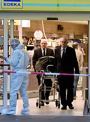 July 28, 2017 - Hamburg, Germany - A deceased person is wheeled from the popular German shopping market Edeka after being stabbed to death by a man who shouted Allahu Akbar. The attacker also slashed four other people in the store. The suspect was apprehended. (Credit Image: © Jeff Widener via ZUMA Wire)