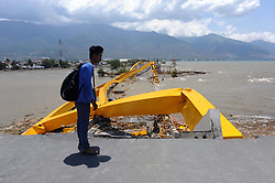 Oct. 2, 2018 - Palu, Indonesia - A man stands by Pesona Palu bridge after it collapsed during an earthquake and tsunami at Talise beach in Palu, Indonesia.  Over 1,234 people were killed in Palu, Donggala district, Parigi Mountong district and North Mamuju district, according to the Disaster Management Institute of Indonesia, Care for Humanity and the Humanity Data Center. (Credit Image: © Agung Kuncahya B/Xinhua via ZUMA Wire)