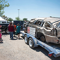The Wilson family take a look at a motor vehicle on display, Saturday, June 8, during McKinley County DWI awareness outside Rio West Mall in Gallup. The motor vehicle on display was involved in a DWI accident in McKinley County resulting in the death of one of the passengers.