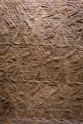A detail of one ancient Assyrian stone panel carving (700-692BC) showing archers attacking the town of Lachish near Jerusalem, in the British Museum, on 11th April 2018, in London, England. The relief was created for the walls of the great palace of the Assyrian king, Sennacherib, in Nineveh. Such scenes demonstrated the consequences of rebelling against the Assyrian empire. Sennacherib is shown as an invincible king presiding over a perfect victory.