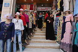 June 24, 2017 - Gaza City, Gaza Strip, Palestinian Territory - Palestinians shop at a market ahead of Eid al-Fitr holiday, in Gaza city on June 24, 2017. Eid al-Fitr marks the end of Muslim's holy fasting month of Ramadan when faithfuls abstain from eating, drinking, smoking and sexual activities from dawn to dusk  (Credit Image: © Ashraf Amra/APA Images via ZUMA Wire)