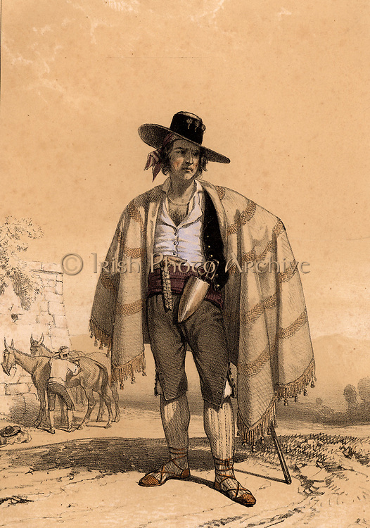 Spanish gipsy muleteer in the Pyrenees wearing a wide brimmed hat and a blanket slung across his shoulders. Trains of mules were a usual means of transporting loads, especially in mountainous districts.  Tinted lithograph from 'Nouvelles Suite de Costumes des Pyrenees' (Paris, c1840).
