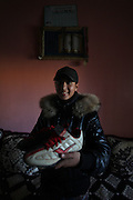 Unveiled soccer .Ibtissam is photographed at her home holding her pair of soccer boots  .Ibtissam is considered to be one of the most promissing soccer athlet in Morocco .Thursday  , 14th January 2010 ,  Sidi-Moumen , outskirts of Casablanca , Morocco. (Photo Joao Henriques )