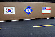 Korean and American flags on a wall at Camp Bonifas located at the Joint Security Area (JSA). Camp Bonifas is home to the United Nations Command Security Battalion whose primary mission is to monitor and enforce the Armistice agreement of 1953 between North and South Korea. South Korea, Republic of Korea, KOR, 23rd of March 2010.