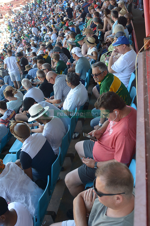 Pretoria 26-12-18. The 1st of three 5 day cricket Tests, South Africa vs Pakistan at SuperSport Park, Centurion. Day 1. Crowds in the shade of the grand stand grandstands as temperatures soared to around 35deg Celcius during the morning session.<br /> <br /> <br /> Picture: Karen Sandison/African News Agency(ANA)