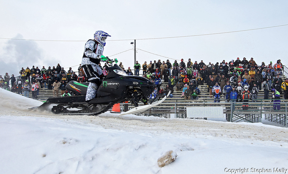 Richard Dvorsky of Cedar Rapids lands in front of one of the grandstands at the Frozen Few 1st Inaugural Amateur Sno-X Race held at Hawkeye Downs, 4400 6th Street SW in Cedar Rapids on Saturday January 22, 2011. 1,200 people turned out to watch over 50 racers in 12 divisions at the event sponsored by the Frozen Few Snowmobile Club. A portion of the proceeds went to the Spina Bifida Association of Iowa. The next race is February 19th.