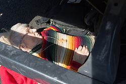 © Licensed to London News Pictures. 15/04/2019. London, UK. Sue Parfitt, 77, an Anglican priest and Extinction Rebellion campaigner, attaches herself to the underneath of a vehicle at Marble Arch, during a day of coordinated actions and blockades throughout London and other UK cities to highlight global climate change. Photo credit: Sean Hawkey/LNP