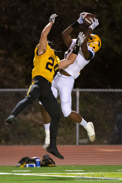 Grant Pacers Keviyez Edwards (35), catches the ball for a touchdown to trail 8-7 as Del Oro Golden Eagles Logan Foster (24), defends after the point after attempt was good as the Del Oro Golden Eagles host the Grant Pacers, Friday Oct 18, 2019.