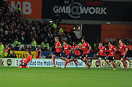 Cardiff city's Kim Bo-Kyung (l) is chased by his teammates after he celebrates scoring a late equaliser to make it 2-2. Barclays Premier League match, Cardiff city v Manchester Utd at the Cardiff city stadium in Cardiff, South Wales on Sunday 24th Nov 2013. pic by Andrew Orchard, Andrew Orchard sports photography,