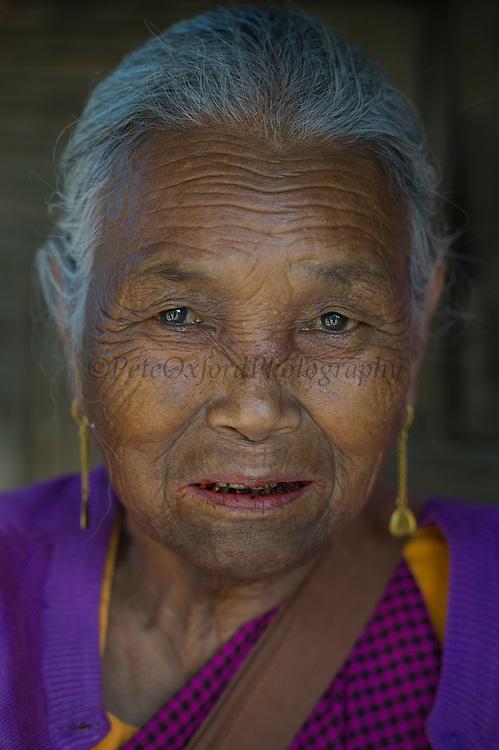 Khasi woman chewing Betel nut<br /> Barabazar market, Shillong<br /> Meghalaya,  ne India