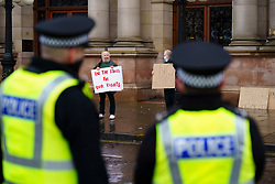 Glasgow, Scotland, UK. 7 January 2020. Anti lockdown protest outside Glasgow City Chambers led by activist Sean Clerkin.  The protesters called on the Scottish Government to remove their ban on the freedom to protest and demonstrate which is contrary to articles 10 and 11 of the European Convention of Human Rights which emphasises freedom of expression and the right to demonstrate and protest.    Iain Masterton/Alamy Live News
