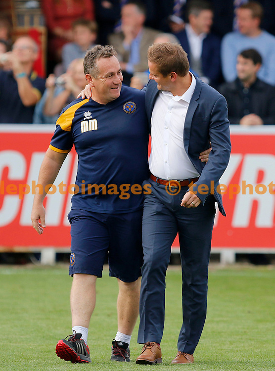 AFC Wimbledon manager, Neal Ardley greets Shrewsbury Town manager, Micky Mellon during the Sky Bet League 1 match between AFC Wimbledon and Shrewsbury Town at the Cherry Red Records Stadium in Kingston. September 24, 2016.<br /> Carlton Myrie / Telephoto Images<br /> +44 7967 642437