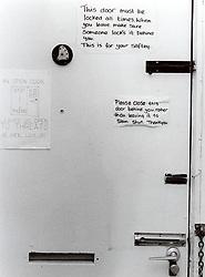 Women's refuge for battered women,  Warning & safety notices on front door; Leeds, UK