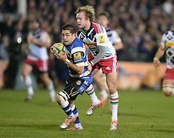 Gavin Henson of Bath Rugby gets tackled by Charlie Matthews of Harlequins  - Photo mandatory by-line: Alex James/JMP - Mobile: 07966 386802 - 28/11/2014 - SPORT - Rugby - Bath - Recreation Ground - Bath  v Harlequins  - Aviva premiership