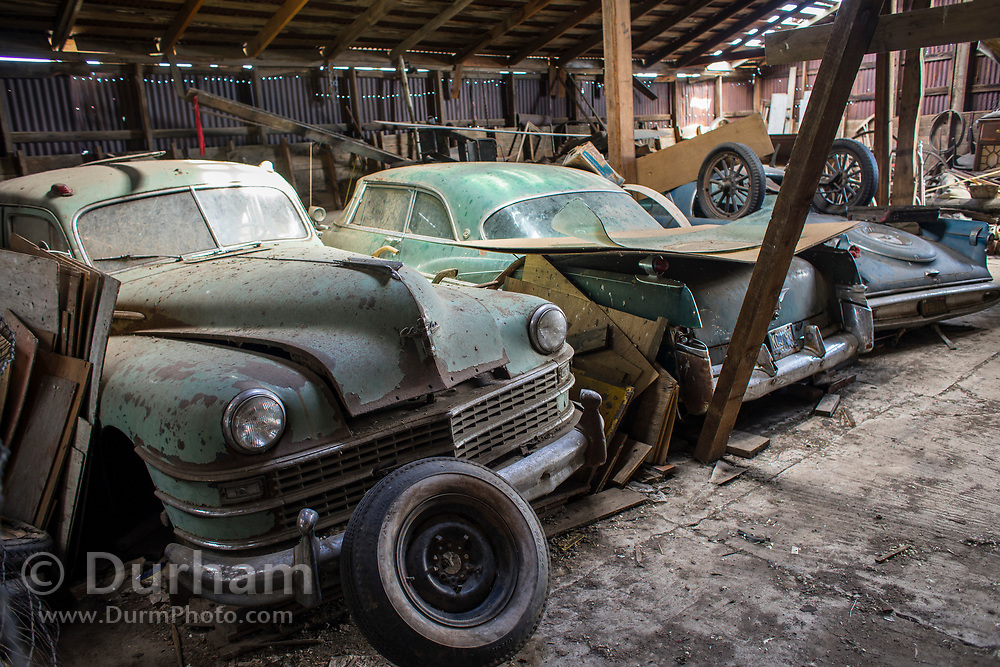 Old cars in a warehouse in Shaniko, Oregon.
