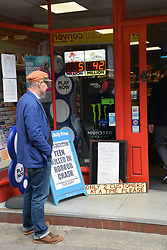 Local shop in Norwich with social distancing sign outside its door during Coronavirus lockdown, UK May 2020. MR