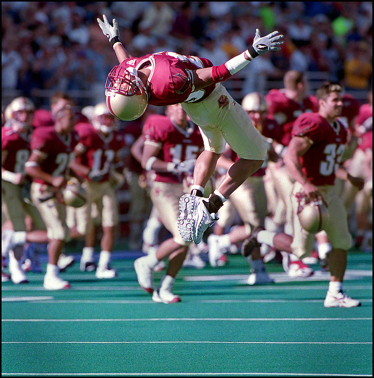 10/14/00.  BC VS SYRACUSE. FLIPPING FOR JOY, #25 D.J. SUTTON DOES A BACK FLIP AFTER BC BEAT SYRACUSE 20-13.  STAFF PHOTO BY MICHAEL SEAMANS SAVED IN PHOTO 6