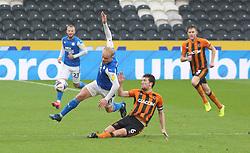 Ryan Broom of Peterborough United is tackled by Richard Smallwood of Hull City - Mandatory by-line: Joe Dent/JMP - 24/10/2020 - FOOTBALL - KCOM Stadium - Hull, England - Hull City v Peterborough United - Sky Bet Championship