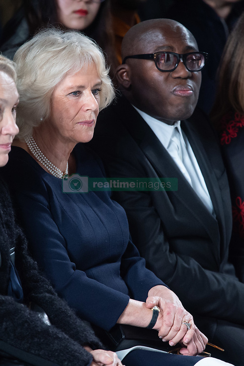 Camilla Parker Bowles, Duchess of Cornwall, and Edward Enninful, editor of Vogue UK, on the front row during the Bethany Williams fashion show, held at the BFC venue at 180 Strand, as part of London Fashion Week A/W 2019. The Duchess was presenting the Queen Elizabeth II Award for Design. Picture date: Tuesday February 19, 2018. Photo credit should read: Matt Crossick/Empics