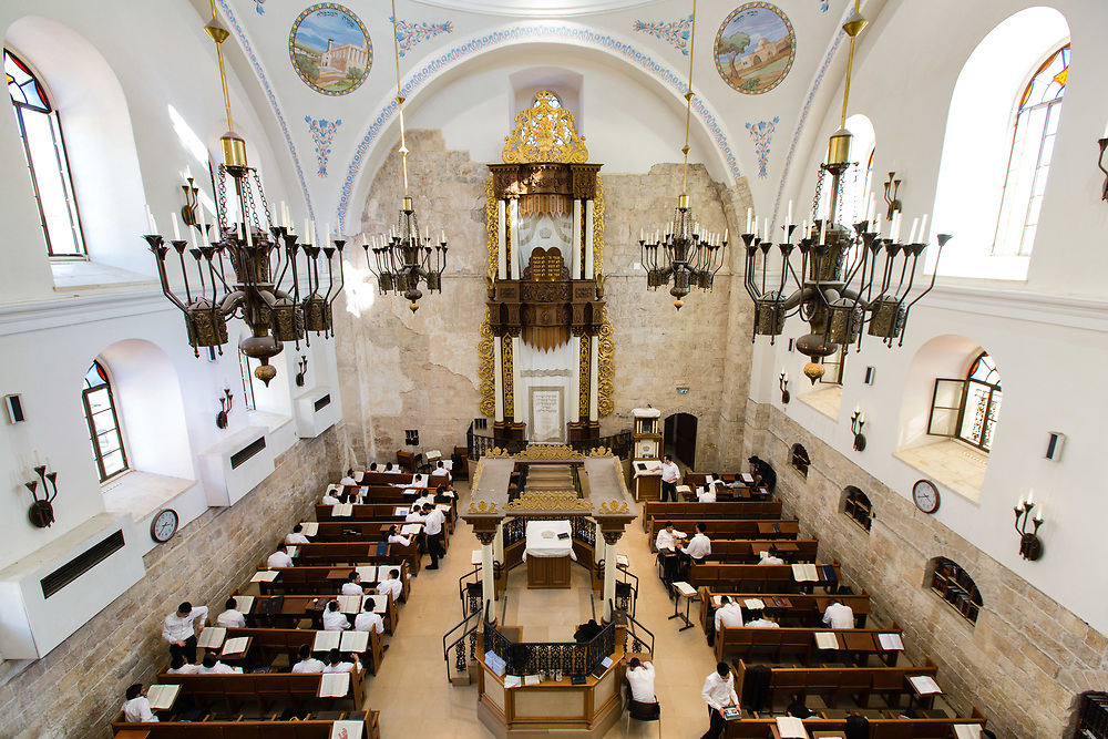 Israeli Jewish men study Torah inside the Hurva synagogue in the Jewish Quarter of the Old City of Jerusalem, on October 6, 2016. The synagogue was destroyed during Israel's 1948 War of Independence and rededicated in 2010.
