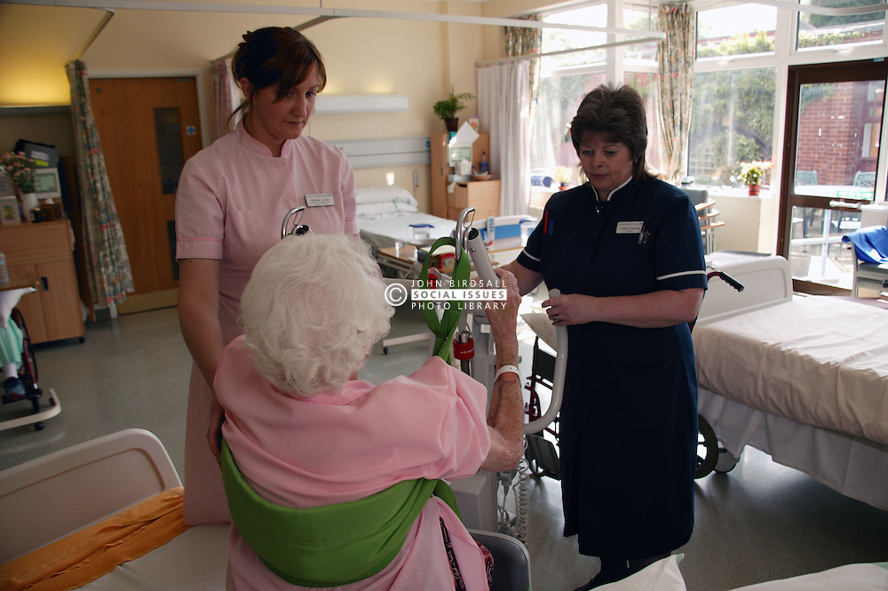 Nurse with disability and health care worker transferring elderly patient; who is nonweight bearing; using Sabina hoist,