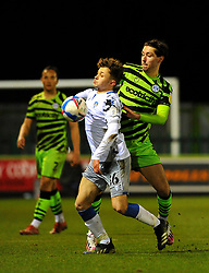 Harvey Sayer of Colchester United competes with Isaac Hutchinson of Forest Green Rovers- Mandatory by-line: Nizaam Jones/JMP - 27/02/2021 - FOOTBALL - The innocent New Lawn Stadium - Nailsworth, England - Forest Green Rovers v Colchester United - Sky Bet League Two