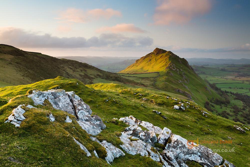 Dawn light picks out Chrome Hill (Dragon's Back) in the Upper Dove Valley. Taken from Tor Rock. White Peak, Derbyshire, Peak District National Park, England, UK.