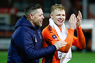 Wimbledon goalkeeping coach Ashley Bayes celebrates victory with Wimbledon goalkeeper Aaron Ramsdale, on loan from Bournemouth,  during the The FA Cup 3rd round match between Fleetwood Town and AFC Wimbledon at the Highbury Stadium, Fleetwood, England on 5 January 2019.
