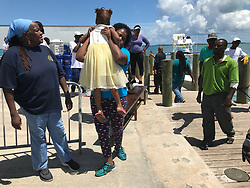 Volunteers in North Eleuthera welcome Hurricane Dorian evacuees from the Abacos on Saturday, Sept. 7. Locals and ex-pats have joined forces to help the hurricane victim who have been unable to get out of Marsh Harbour and Treasure Cay in the Abacos, which were devastated by the Category 5 storm. Photo by Jacqueline Charles/Miami Herald/TNS/ABACAPRESS.COM