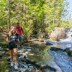 Teenagers hike at Red River Falls in Aroostook County, Maine. Deboullie Public Reserve Land.